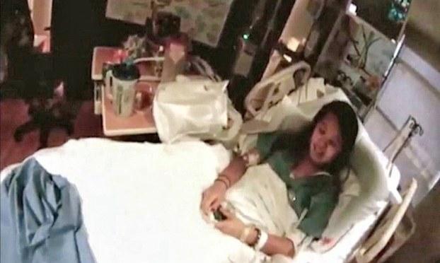Nữ y tá hết lòng vì bệnh nhân
